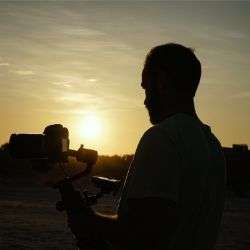 Videographer in the sunset