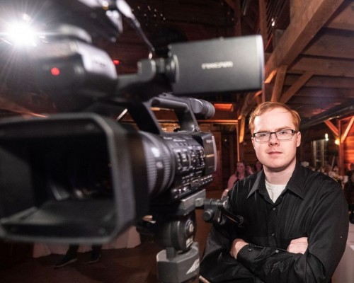 Akron Wedding Videographer Recording An Event